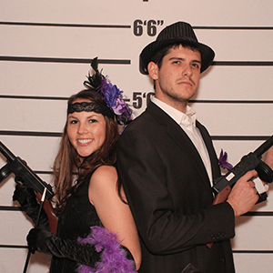 San Francisco Murder Mystery party guests pose for mugshots